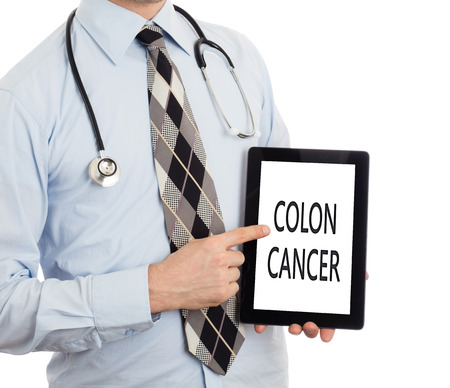 Doctor, isolated on white backgroun,  holding digital tablet - Colon cancer