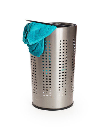 accouterment: Dirty laundry in a metal basket, isolated on a white background Stock Photo