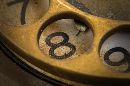 dialplate: Close up of Vintage phone dial, dirty and scratched - 8, perspective Stock Photo