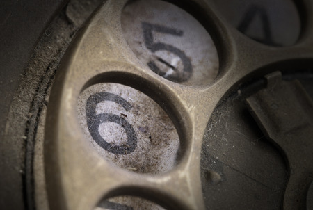 dialplate: Close up of Vintage phone dial, dirty and scratched - 6, perspective Stock Photo