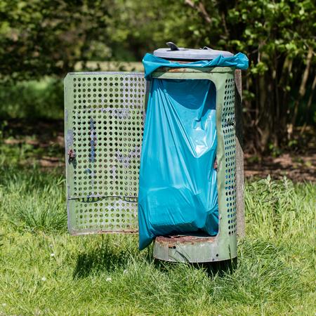 receptacle: Broken litter bin in the park, the Netherlands