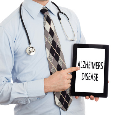 brain aging: Doctor, isolated on white backgroun,  holding digital tablet - Alzheimers disease