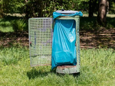Broken litter bin in the park, the Netherlands