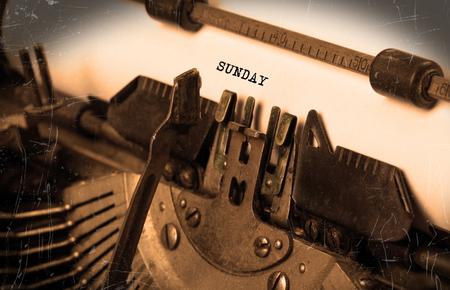 sunday paper: Sunday typography on a vintage typewriter, close-up Stock Photo