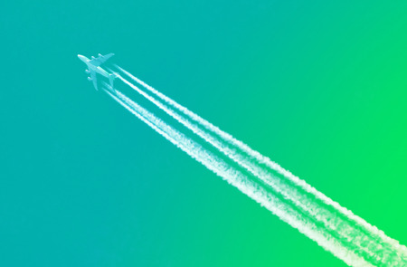 sky diving: Large aircraft flying in sky, 4 stripes in the sky - Bright green sky