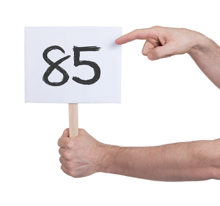 studding: Sign with a number, isolated on white - 85 Stock Photo