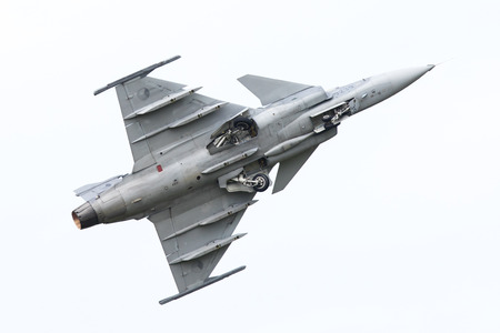 airshow: LEEUWARDEN, THE NETHERLANDS-JUNE 10: Modern tactical fighter jet JAS-39 Gripen performs at the Dutch Airshow on June 10, 2016 at Leeuwarden Airfield, The Netherlands.