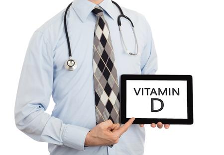 vitamin d: Doctor, isolated on white backgroun,  holding digital tablet - Vitamin D
