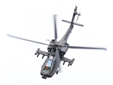 airscrew: LEEUWARDEN, THE NETHERLANDS - JUN 11, 2016: Boeing AH-64 Apache attack helicopter flying a demo during the Royal Netherlands Air Force Days
