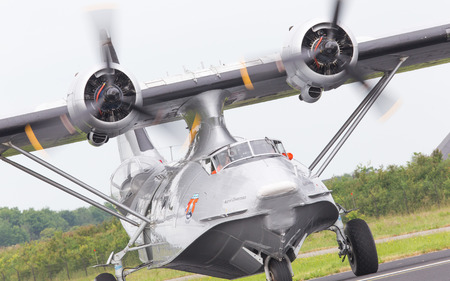 consolidated: LEEUWARDEN, NETHERLANDS - JUNE 11: Consolidated PBY Catalina in Dutch Navy colors flying at the Royal Netherlands Air Force Days June 11, 2016 in Leeuwarden, Netherlands.