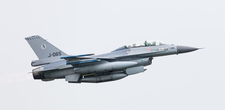 days off: LEEUWARDEN, THE NETHERLANDS - JUN 11, 2016: Dutch F-16 fighter jet take off during the Royal Netherlands Air Force Days Editorial