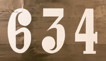 old plane: Painted number on an old plane, isolated Stock Photo