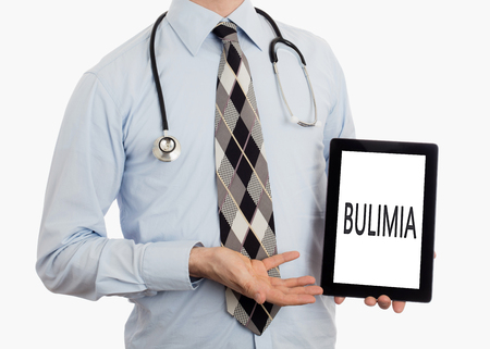 bulimia: Doctor, isolated on white backgroun,  holding digital tablet - Bulimia Stock Photo