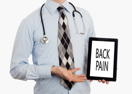 spondylosis: Doctor, isolated on white backgroun,  holding digital tablet - Back pain Stock Photo