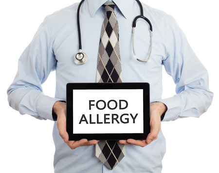 food allergy: Doctor, isolated on white background,  holding digital tablet - Food allergy Stock Photo