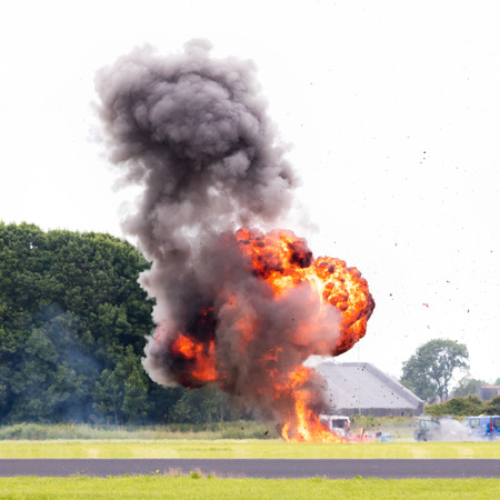 pyromania: Airfield planned explosion, selective focus on the fireball