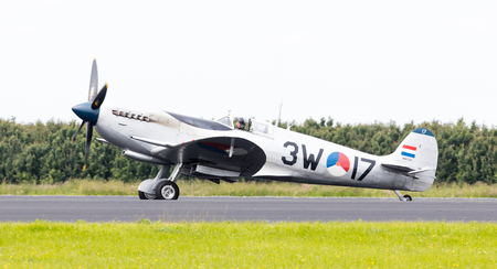 LEEUWARDEN, THE NETHERLANDS - JUNE 10, 2016: A vintage Spitfire fighter plane on the runway during a demonstration at the Royal Netherlands Air Force Days at Leeuwarden on June 10, 2016.