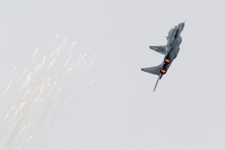LEEUWARDEN, THE NETHERLANDS - JUNE 11, 2016: Slovak Air Force MiG-29 Fulcrum firing off flares during a demonstration at the Royal Netherlands Air Force Days Editorial