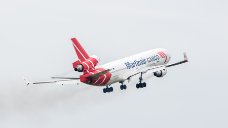md: LEEUWARDEN, THE NETHERLANDS - JUNE 11, 2016: PH-MCU Martinair Holland McDonnell Douglas MD-11 during a demonstration at the Royal Netherlands Air Force Days Editorial