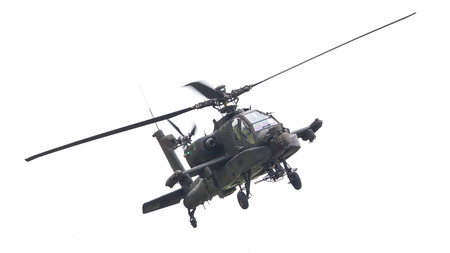 warfare: LEEUWARDEN, THE NETHERLANDS - JUN 11, 2016: Boeing AH-64 Apache attack helicopter flying a demo during the Royal Netherlands Air Force Days