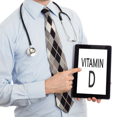 vitamin d: Doctor, isolated on white background,  holding digital tablet - Vitamin D