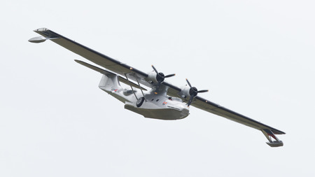 consolidated: LEEUWARDEN, NETHERLANDS - JUNE 10: Consolidated PBY Catalina in Dutch Navy colors flying at the Royal Netherlands Air Force Days June 10, 2016 in Leeuwarden, Netherlands. Editorial