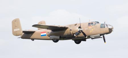 ww2: LEEUWARDEN, THE NETHERLANDS - JUNE 10: WW2 B-25 Mitchell bomber in Dutch markings during the Dutch Air Force Open House. June 10, 2016 in Leeuwarden, The Netherlands