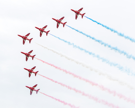 raf: LEEUWARDEN, THE NETHERLANDS - JUNE 10, 2016: RAF Red Arrows performing at the Dutch Air Force Open House on June 10, 2016 at Leeuwarden Airfield, The Netherlands.
