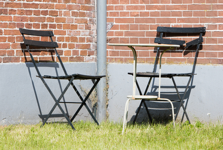 Garden chairs and table on the grass