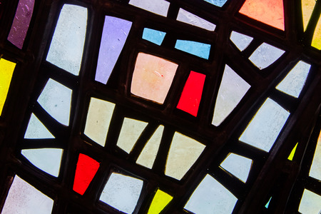 diagonals: Image of a multicolored stained glass window with irregular block pattern