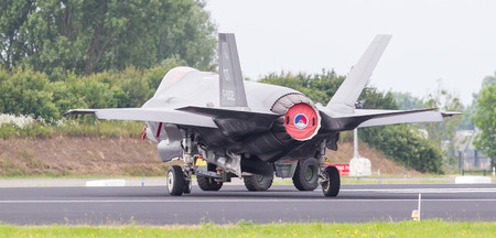 towed: LEEUWARDEN, NETHERLANDS - JUNE 11 2016: F35 Joint Strike Fighter is towed to the hangar after a demonstration flight at the Dutch Air Force on juni 11 ,2016 in Leeuwarden.