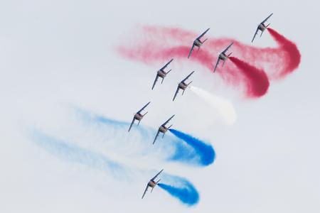 LEEUWARDEN, THE NETHERLANDS-JUNE 11, 2016: Pilots of Patrouille de France perform acrobatics at the Dutch Airshow on June 11, 2016 at Leeuwarden Airfield, The Netherlands.