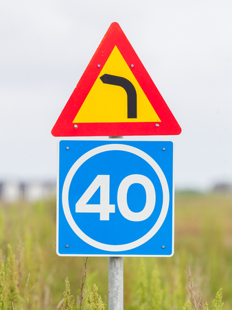 advisory: Curve with advisory speed limit sign in Iceland