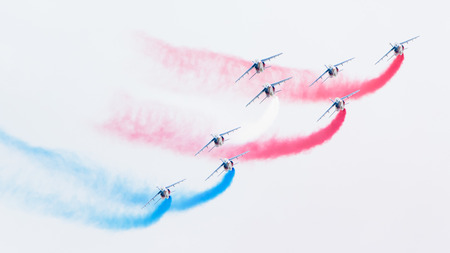 aerobatics: LEEUWARDEN, THE NETHERLANDS-JUNE 11, 2016: Pilots of Patrouille de France perform acrobatics at the Dutch Airshow on June 11, 2016 at Leeuwarden Airfield, The Netherlands.