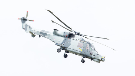 westland: LEEUWARDEN, THE NETHERLANDS - JUNE 11, 2016: Royal Navy (Black Cats Display Team) Agusta Westland AW-159 Wildcat HMA2 performing some flights at the Royal Netherlands Air Force Days