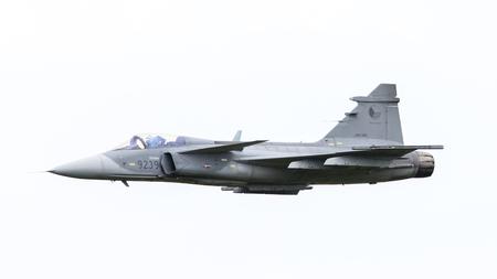 war bird: LEEUWARDEN, THE NETHERLANDS-JUNE 10: Modern tactical fighter jet JAS-39 Gripen performs at the Dutch Airshow on June 10, 2016 at Leeuwarden Airfield, The Netherlands.