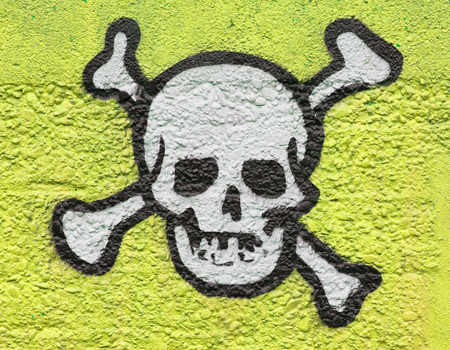 Simple black an white skull on a yellow wall Stock Photo