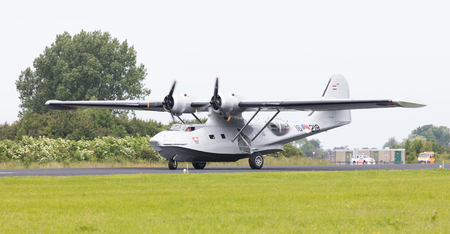 LEEUWARDEN, NETHERLANDS - JUNE 10: Consolidated PBY Catalina in Dutch Navy colors flying at the Royal Netherlands Air Force Days June 10, 2016 in Leeuwarden, Netherlands. Editorial