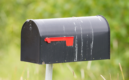 metal post: Rural mailbox on a metal post out on a country road