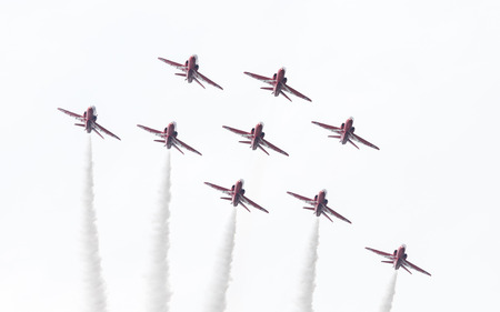 LEEUWARDEN, THE NETHERLANDS - JUNE 10, 2016: RAF Red Arrows performing at the Dutch Air Force Open House on June 10, 2016 at Leeuwarden Airfield, The Netherlands.