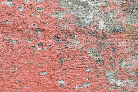 deteriorated: Closeup of chipped paint on old red wall