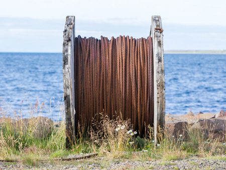 Abandoned rusty steel cable, coast of Iceland Stock Photo