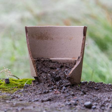 Broken flower pot, stil filled with dirt Stok Fotoğraf
