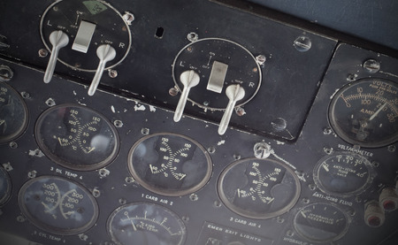displays: Different meters and displays in the console of an old plane Stock Photo