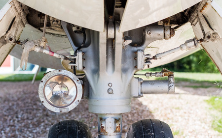 chock: Close up aircraft nose landing gear on the tarmac with chock at the tire Stock Photo