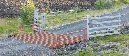 cattle grid: Cattle grid in the typical Icelandic landscape