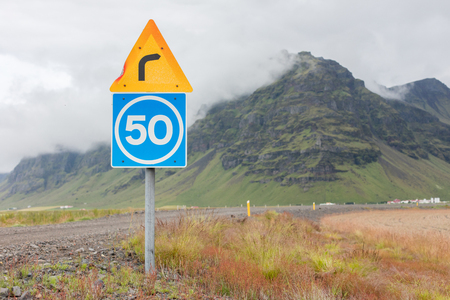 advisory: Curve with advisory speed limit in Iceland