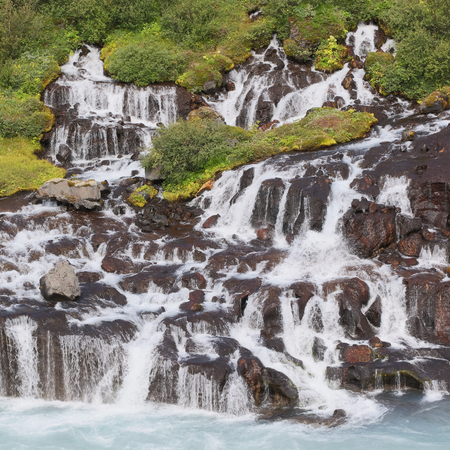 Hraunfossar waterfalls and cascade, a popular tourist destination in western Iceland Stock Photo