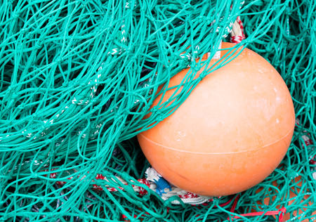 trawl: Abstract background with a pile of fishing nets ready to be cast overboard for a new days fishing