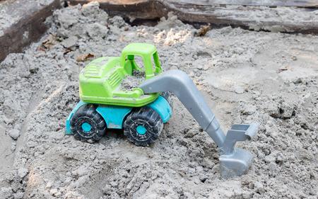 industrail: Toy trucks on sand playground, industrail symbols